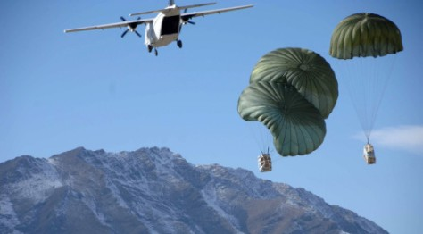 Blackwater CASA 212 over Afghanistan dropping supplies to U.S. Army soldiers